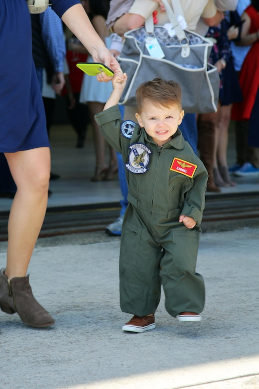 The son of Capt. Vincent Gonzalez waits for his father, Capt. Vincent Gonzalez, during a deployment homecoming aboard Marine Corps Air Station Cherry Point, N.C., Oct. 10, 2016. More than 20 air crew members with Marine Tactical Electronic Warfare Squadron 4 returned after a six-month deployment with the United States Central Command aboard Incirlik Air Base in Turkey. According to Lt. Col. Paul K. Johnson III, commanding officer for VMAQ-4, the Marines conducted electronic warfare and disrupted ISIS communications in Iraq and Syria in support of Operation Inherent Resolve. This deployment was the last that VMAQ-4 will participate in because the squadron is scheduled to be deactivated in the summer of 2017. Gonzalez is an electronic warfare officer with VMAQ-4. (U.S. Marine Corps photo by Lance Cpl. Mackenzie Gibson/Released)