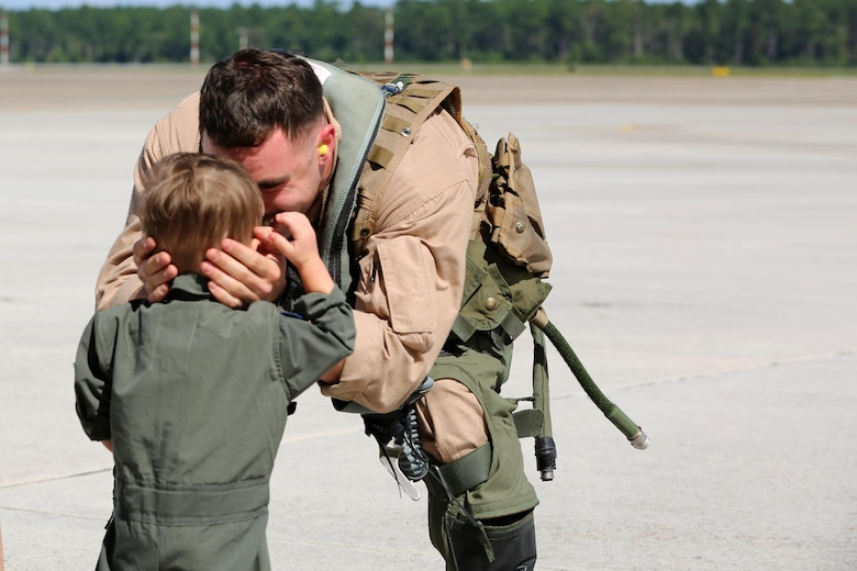 Capt. Vincent Gonzalez embraces his son during a deployment homecoming aboard Marine Corps Air Station Cherry Point, N.C., Oct. 10, 2016. More than 20 air crew members with Marine Tactical Electronic Warfare Squadron 4 returned after a six-month deployment with the United States Central Command aboard Incirlik Air Base in Turkey. According to Lt. Col. Paul K. Johnson III, commanding officer for Marine Tactical Electronic Warfare Squadron 4, the Marines conducted electronic warfare and disrupted ISIS communications in Iraq and Syria in support of Operation Inherent Resolve. This deployment was the last that VMAQ-4 will participate in because the squadron is scheduled to be deactivated in the summer of 2017. Gonzalez is an electronic warfare officer with VMAQ-4. (U.S. Marine Corps photo by Lance Cpl. Mackenzie Gibson/Released)