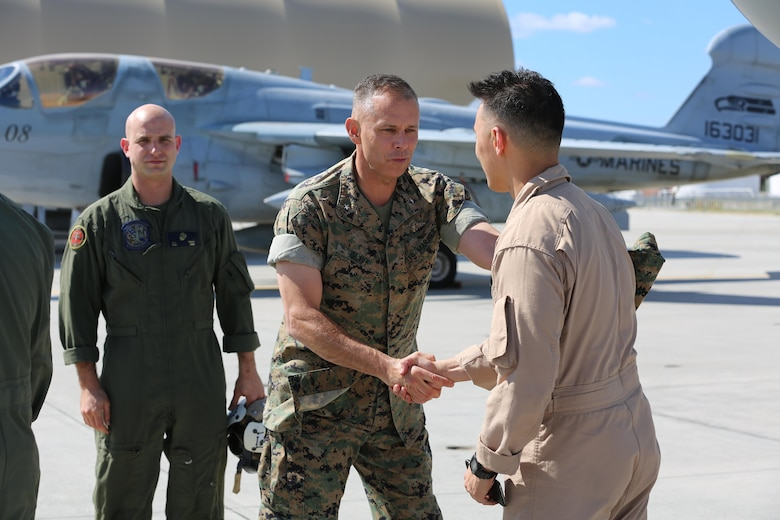 Brig. Gen. Matthew Glavy welcomes Marines home during a deployment homecoming aboard Marine Corps Air Station Cherry Point, N.C., Oct. 10, 2016. More than 20 air crew members with Marine Tactical Electronic Warfare Squadron 4 returned after a six-month deployment with the United States Central Command aboard Incirlik Air Base in Turkey. According to Lt. Col. Paul K. Johnson III, commanding officer for VMAQ-4, the Marines conducted electronic warfare and disrupted ISIS communications in Iraq and Syria in support of Operation Inherent Resolve. This deployment was the last that VMAQ-4 will participate in because the squadron is scheduled to be deactivated in the summer of 2017. Glavy is the commanding general for 2nd Marine Aircraft Wing. (U.S. Marine Corps photo by Lance Cpl. Mackenzie Gibson/Released)