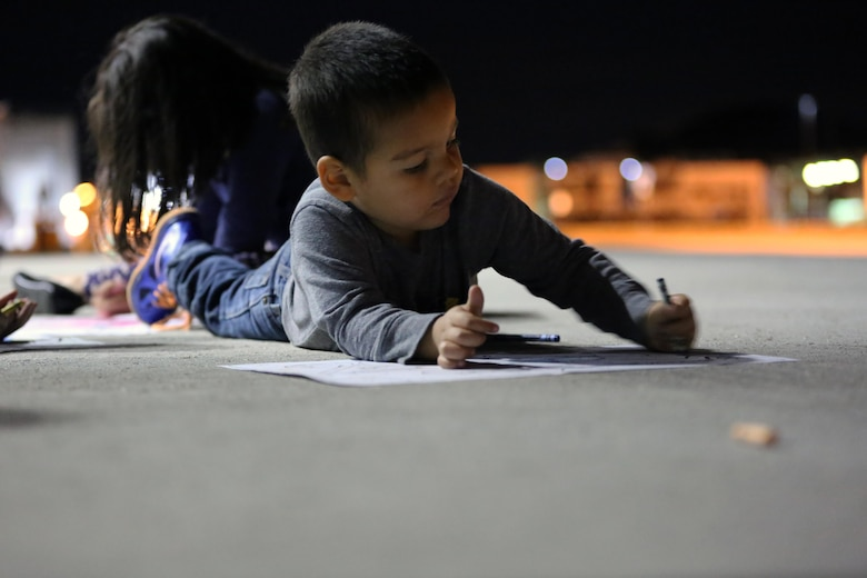 "A child creates a ""welcome home"" poster for their loved one during a deployment homecoming aboard Marine Corps Air Station Cherry Point, N.C., Oct. 15, 2016. More than 120 Marines with Marine Tactical Electronic Warfare Squadron 4 returned after a six-month deployment with the United States Central Command aboard Incirlik Air Base in Turkey. According to Lt. Col. Paul K. Johnson III, commanding officer for VMAQ-4, the Marines conducted electronic warfare and disrupted ISIS communications in Iraq and Syria in support of Operation Inherent Resolve. This deployment was the last that VMAQ-4 will participate in because the squadron is scheduled to be deactivated in the summer of 2017. (U.S. Marine Corps photo by Lance Cpl. Mackenzie Gibson/Released)"