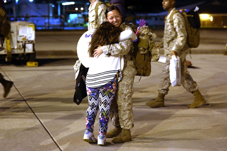 A Marine embraces her loved one during a deployment homecoming aboard Marine Corps Air Station Cherry Point, N.C., Oct. 15, 2016. More than 120 Marines with Marine Tactical Electronic Warfare Squadron 4 returned after a six-month deployment with the United States Central Command aboard Incirlik Air Base in Turkey. According to Lt. Col. Paul K. Johnson III, commanding officer for VMAQ-4, the Marines conducted electronic warfare and disrupted ISIS communications in Iraq and Syria in support of Operation Inherent Resolve. This deployment was the last that VMAQ-4 will participate in because the squadron is scheduled to be deactivated in the summer of 2017. (U.S. Marine Corps photo by Lance Cpl. Mackenzie Gibson/Released)