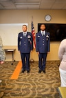 Lt. Col. Andre Wright, 94th Civil Engineer Squadron commander, and Col. Marty Hughes, 94th Mission Support Group commander, stand tall at attention during the Air Force Song. Many civil engineer Airmen came in support of Wright's promotion. (U.S. Air Force photo by Senior Airman Lauren Douglas)
