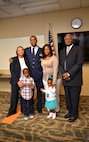 Newly promoted Lt. Col. Andre Wright, 94th Civil Engineer Squadron, stands with his family after his ceremony of promotion at Dobbins Air Reserve Base on October 15, 2016. Wright's father, a retired Air Force chief, delivered the invocation and his family pinned on his new rank. (U.S. Air Force photo by Senior Airman Lauren Douglas)