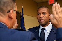 Newly promoted Lt. Col. Andre Wright, 94th Civil Engineer Squadron, is sworn in during his ceremony of promotion at Dobbins Air Reserve Base on October 15, 2016. Col. Marty Hughes, 94th Mission Support Group commander, was the presiding officer. (U.S. Air Force photo by Senior Airman Lauren Douglas)