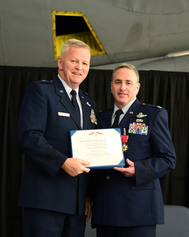U.S. Air Force Big. Gen. Paul Hutchinson, commander, New Hampshire Air National Guard, presents Col. Peter Sullivan, 157th Air Refueling Wing vice wing commander, with a retirement certificate during Sullivan's retirement ceremony, Pease Air National Guard Base, N.H., Oct. 15, 2016.  Sullivan retires with 34 years of service.  (U.S. Air National Guard photo by Senior Airman Ashlyn J. Correia)