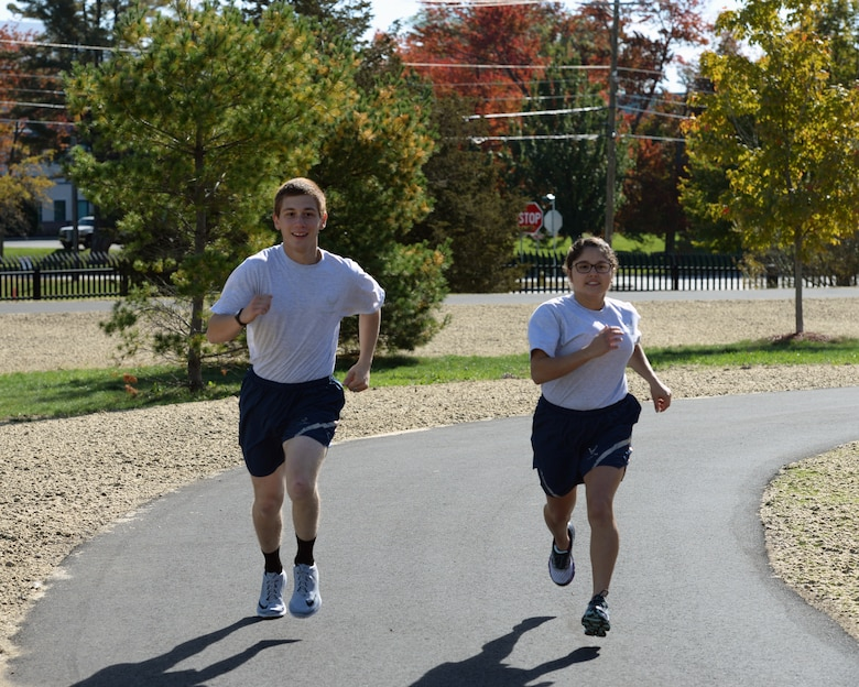 U.S. Air Force Airman 1st Class Matthew Caporale and Airman 1st Class Arielle Longhi take a run on the new running track, Pease Air National Guard Base, N.H., Oct. 15, 2016. The purpose of the new track is to give Airmen a safe, dedicated space for running in preparation for and execution of fitness tests, as well as to enhance personal physical fitness.  (U.S. Air National Guard photo by Staff Sgt. Curtis J. Lenz)