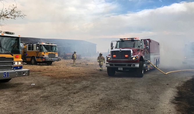A Nevada Air National Guard fire tender re-supplies fire engines from multiple governmental agencies during the Little Valley Fire that burned 22 homes Friday. Photo courtesy Nevada Air National Guard Fire Emergency Services
