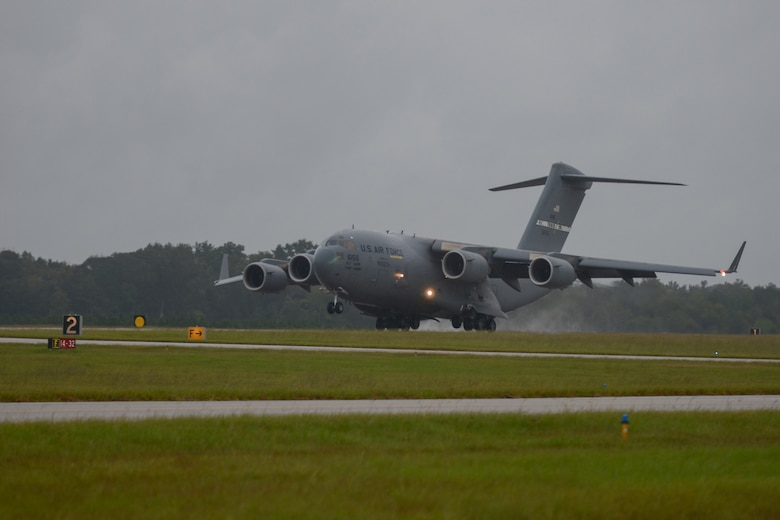 A U.S. C-17 Globemaster III, a large military transport aircraft, belonging to the 21st Airlift Squadron from Travis AFB, Calif., lands at McEntire Joint National Guard Base, S.C., Oct. 7, 2016. Equipment from the South Carolina Air National Guard's 245th Air Traffic Control Squadron was loaded onto the aircraft in preparation for a deployment in support of Operation INHERENT RESOLVE. (U.S. Air National Guard photo by Airman 1st Class Megan Floyd)