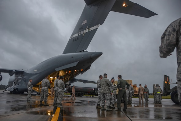 A U.S. C-17 Globemaster III, a large military transport aircraft, belonging to the 21st Airlift Squadron from Travis AFB, Calif., is being loaded at McEntire Joint National Guard Base, S.C., Oct. 7, 2016. Equipment from the South Carolina Air National Guard's 245th Air Traffic Control Squadron was loaded onto the aircraft in preparation for a deployment in support of Operation INHERENT RESOLVE. (U.S. Air National Guard photo by Airman 1st Class Megan Floyd)