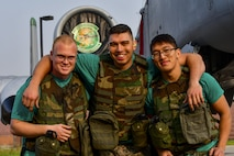 U.S. Air Force Staff Sgt. Kyle Dixon, 25th Aircraft Maintenance Unit weapons load crew lead, middle, poses with Senior Airmen Zachery Wright, left, and Huy Diep, right, 25th AMU weapons load crew members, at Osan Air Base, Republic of Korea, Oct. 14, 2015. The three Airmen had just finished competing in the 51st Maintenance Group's Weapons Load Crew of the Quarter competition against the 36th AMU. (U.S. Air Force photo by Senior Airman Victor J. Caputo)