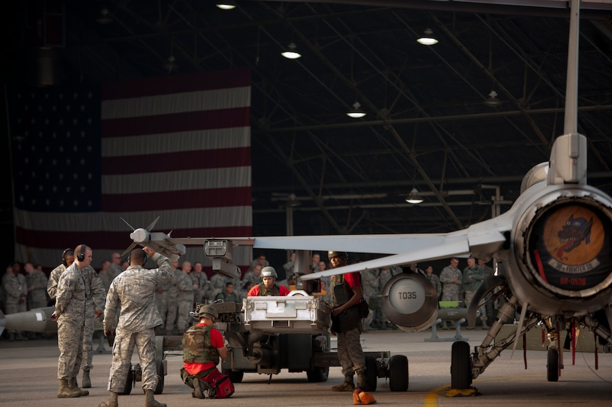 Team Osan 36th Aircraft Maintenance Unit weapons load team members load an AGM-88 HARM onto an F-16 Fighting Falcon during the 51st Maintenance Group's Weapons Load Crew of the Quarter competition at Osan Air Base, Republic of Korea, Oct. 14, 2016. The AGM-88 Harm is an air-to-surface tactical missile designed to seek and destroy enemy radar-equipped air defense systems. (U.S. Air Force photo by Staff Sgt. Jonathan Steffen)