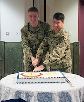 "161013-N-YB753-049 NAVAL SUPPORT ACTIVITY BAHRAIN (Oct. 13, 2016) Petty Officer 3rd Class Michael Joy, left, cuts the Navy birthday cake with Vice Adm. Kevin Donegan, Commander U.S. Naval Forces Central Command, during a ceremony honoring the Navy's 241st birthday at Naval Support Activity Bahrain. In keeping with naval tradition, the youngest and oldest Sailors present have the first pieces of cake. Sailors worldwide observed the Navy birthday on Oct. 13 with this year's theme of ""America's Sailor: For 241 years, Tough, Bold and Ready."""
