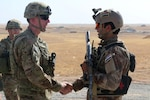 U.S. Army Maj. Gen. Gary J. Volesky, left, commander, Combined Joint Forces Land Component Command – Operation Inherent Resolve, visits with an Iraqi soldier at a tactical assembly area in  northern Iraq, Iraq, prior to the start of the Mosul offensive, Oct. 10, 2016. The TAAs are where ISF assembled prior to making their push toward Mosul. A Coalition of regional and international nations have joined together to defeat the Islamic State of Iraq and the Levant and the threat they pose to Iraq, Syria, the region and the wider international community. (U.S. Army photo by Sgt. 1st Class R.W. Lemmons IV)