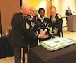 LEFT TO RIGHT: Command Sgt. Maj. Billy Counts II, 97th Military Police Battalion, Staff Sgt. Martin Fox, the oldest MP in the battalion; Pfc. Erica Hall, the youngest MP in the battalion, and Lt. Col. Alexander Murray, commander of the 97th MP Bn., cut the cake at the MP ball Sept. 30 at the Courtyard by Marriott in Junction City, Kansas. The ball was the final event of the week-long celebration of the 75th birthday of the Military Police Corps.