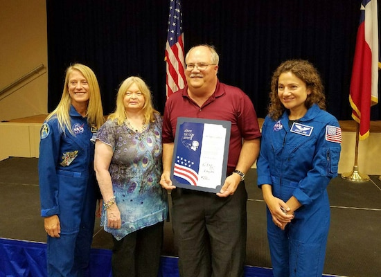 Lewis Godfrey, Defense Contract Management Agency NASA Product Operations quality assurance specialist, and his wife Lois, stand with astronauts Karen Nyberg and Jessica Meir following the presentation of the Silver Snoopy award during a ceremony held at the Johnson Space Center in Houston in August. (Courtesy photo)