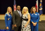 Tracy Jones, Defense Contract Management Office Phoenix lead quality assurance specialist, and his wife Melody, stand with astronauts Karen Nyberg and Jessica Meir following the presentation of the Silver Snoopy award during a ceremony held at the Johnson Space Center in Houston in August. (Courtesy photo)