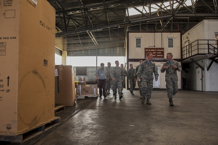 U.S. Air Force Col. Thomas Cooper, 521st Air Mobility Operation Wing commander from Ramstein Air Force Base, Germany, speaks with Airmen from the 728th Air Mobility Squadron (AMS) about their operations Oct. 14, 2016, at Incirlik Air Base, Turkey. Cooper visited Incirlik to better understand 728th AMS operations. (U.S. Air Force photo by Staff Sgt. Jack Sanders)
