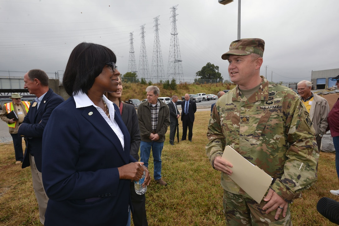Maj. Christopher W. Burkhart, U.S. Army Corps of Engineer, Nashville District deputy district engineer, welcomes Kentucky Lt. Gov. Jenean Hampton to the Kentucky Lock Addition Project at Kentucky Lake Oct. 13, 2016.