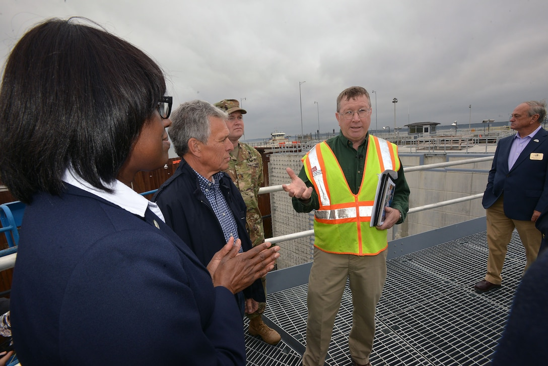Don Getty, project manager for the Kentucky Lock Addition Project, leads Kentucky Lt. Gov. Jenean Hampton and 12 board board members from the Tennessee Tombigbee Waterway Development Authority on a tour at the Kentucky Lock Addition Project in Grand Rivers, Ky., Oct. 13, 2016.