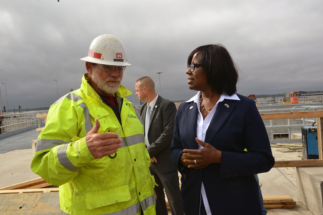 Mark Gibson, an engineer with the U.S. Army Corps of Engineers, Nashville District briefs Kentucky Lt. Gov. Jenean Hampton during a tour at the Kentucky Lock Addition Project.