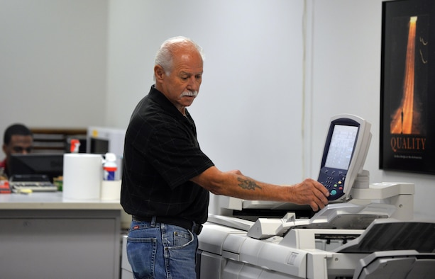 Joe Knott, an electronic duplicating systems technician with Defense Logistic Agencies Document Services, runs copies of a Xerox 4112 inside of the document services print shop located in the Martin Bomber Building on Oct. 6, Offutt Air Force Base, Neb.  The Offutt AFB Document Services is the only print shop qualified to perform duplication of classified, hard-copy documents.