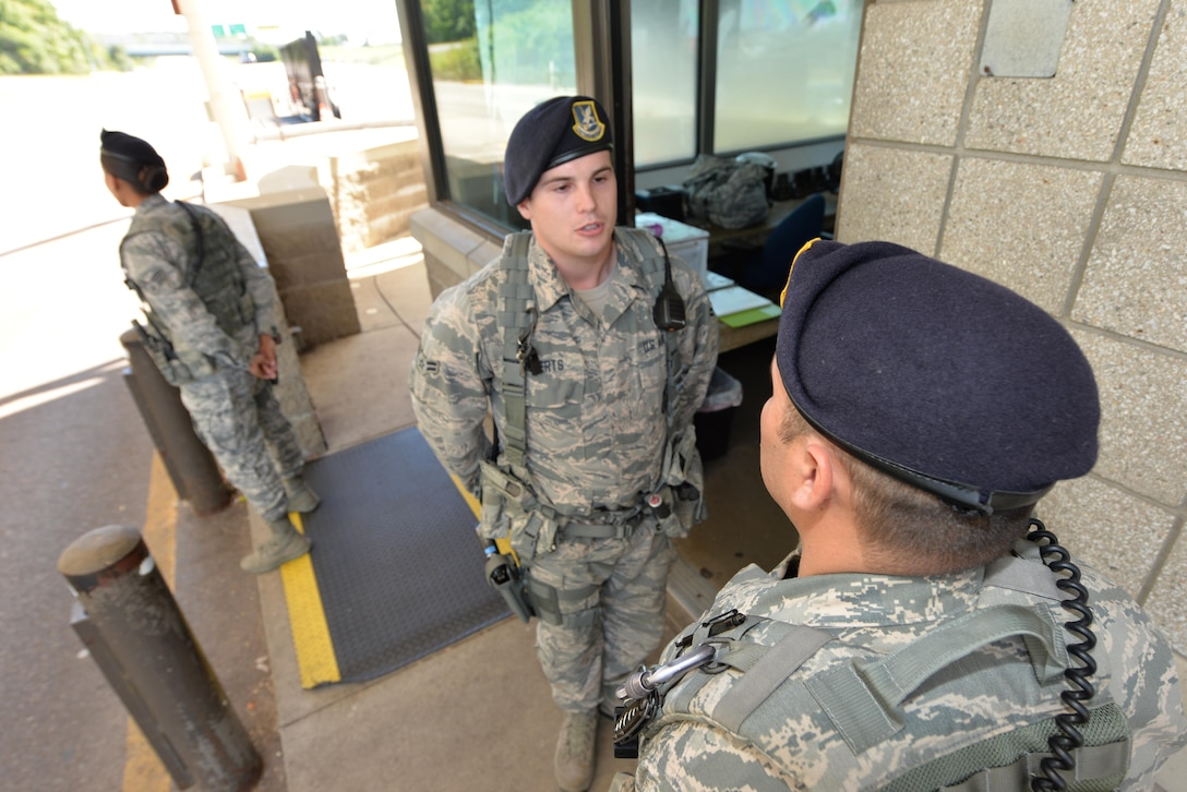 U.S. Air Force Technical Sergeant Esteban Calderon, 88th Security Forces Squadron duty flight chief, quires Airman First Class Tanner Roberts, 88th SFS installation entry controller, on his area of responsibility during his duty shift at gate 22B Wright Patterson Air Force Base, Sept 12, 2016. Personnel assigned to this duty verify requests for visitor entry; issue visitor passes, and enforce the installation traffic code. Entry controllers may search and inspect personnel and vehicles, as directed by higher authority. As Air Force ambassadors, installation entry controllers play a vital role on Air Force installations. (U.S. Air Force photo/Al Bright)