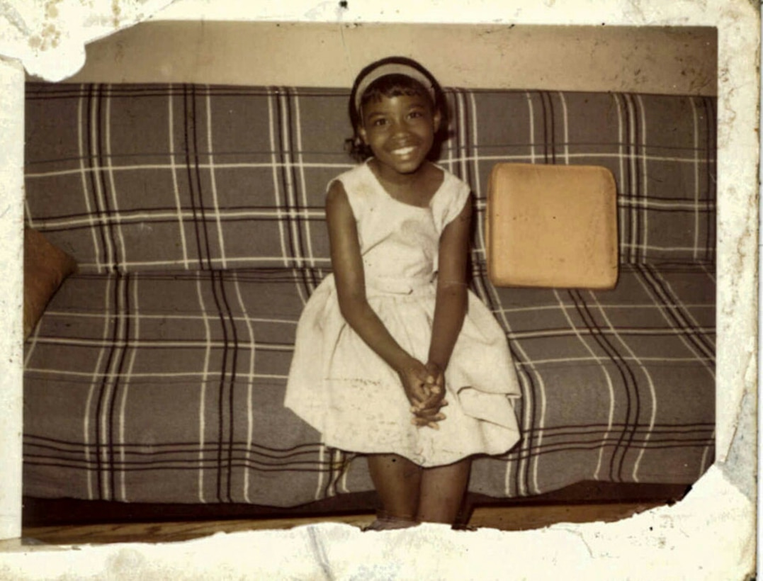 Seven year-old Frances Culpepper on the couch when her family first moved to Chicago from Mississippi. Culpepper worked through the ranks to retire as a Sgt. Major in 2016. (Photo courtesy of her mother).
