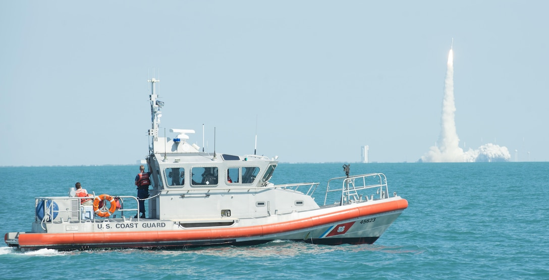 A boatcrew from Coast Guard Station Port Canaveral, Florida, enforces a safety and security zone during a rocket launch from the Kennedy Space Center (off the coast of Cape Canaveral, Fla.), June 24, 2016.