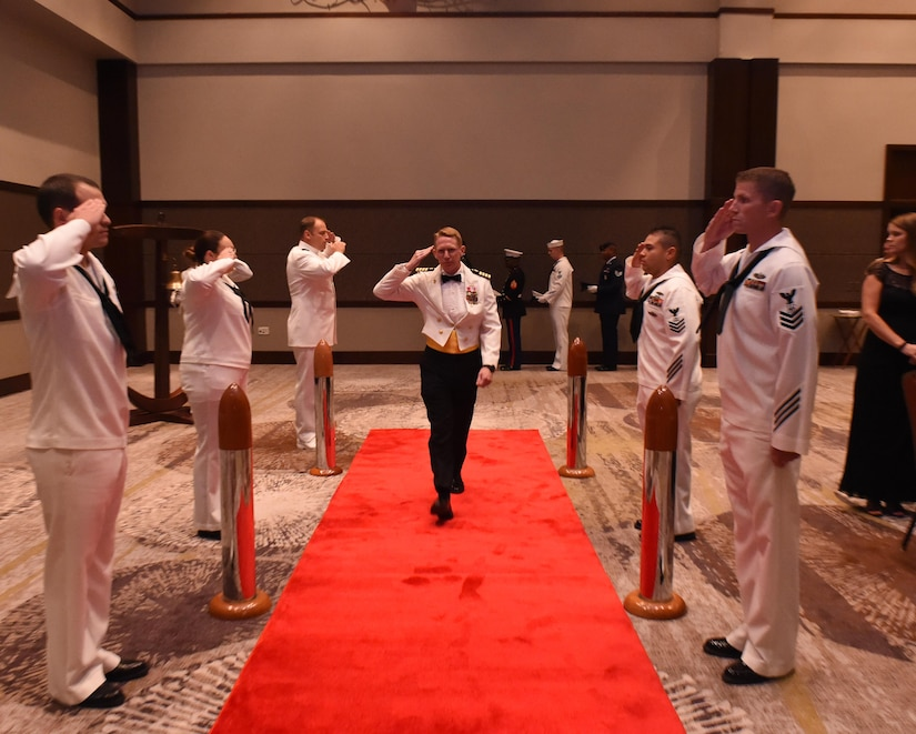 U.S. Navy Capt. Robert Hudson, Joint Base Charleston deputy commander, is piped aboard at the start of the Navy Ball at the Embassy Suites Hotel on Oct. 15. Hudson was the guest speaker for the evening.