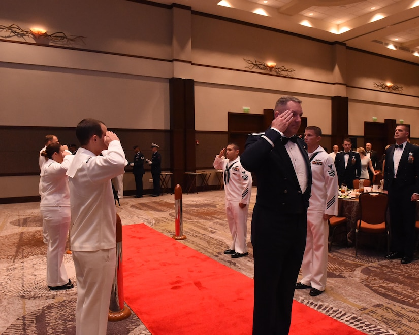 Col. Robert Lyman, Joint Base Charleston commander, is piped aboard at the start of the Navy Ball at the Embassy Suites Hotel on Oct. 15. The Navy Ball celebrated the Navy's 241st birthday.