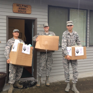 Technical Sgt. Zachary Palomo, Senior Airman Brian Dooley, and Senior Airman Jonathan Jones, from the 446th Operations Support Squadron, delivered donations Oct. 16, 2016, to the Helping Hand House charity organization in Puyallup, Wash. Rainier Wing Airmen delivered more than 300 toiletry and sanitary items to those in need. (U.S. Air Force Reserve photo by 2nd Lt. Alyssa Hudyma/Released)