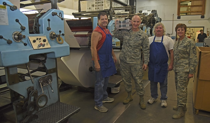 Cheney Free Press pressmen conclude the tour for Fairchild Leadership Oct. 13, 2016, at Cheney. The tour included the start to finish process of producing the Fairchild Flyer. Each newspaper is created using locally sourced newsprint, weighing in at nearly 800 pounds when on the roll. (U.S. Air Force photo/Senior Airman Mackenzie Richardson)