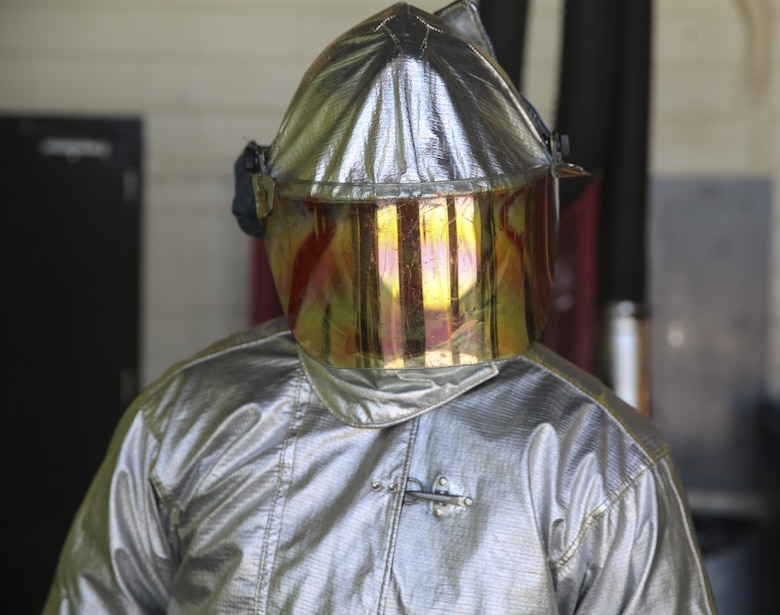 Cpl. Ryan Sargent wears his fire suit aboard Marine Corps Air Station Cherry Point, N.C., July 18, 2016. Sargent is a firefighter with Aircraft, Rescue and Firefighting aboard MCAS Cherry Point.
