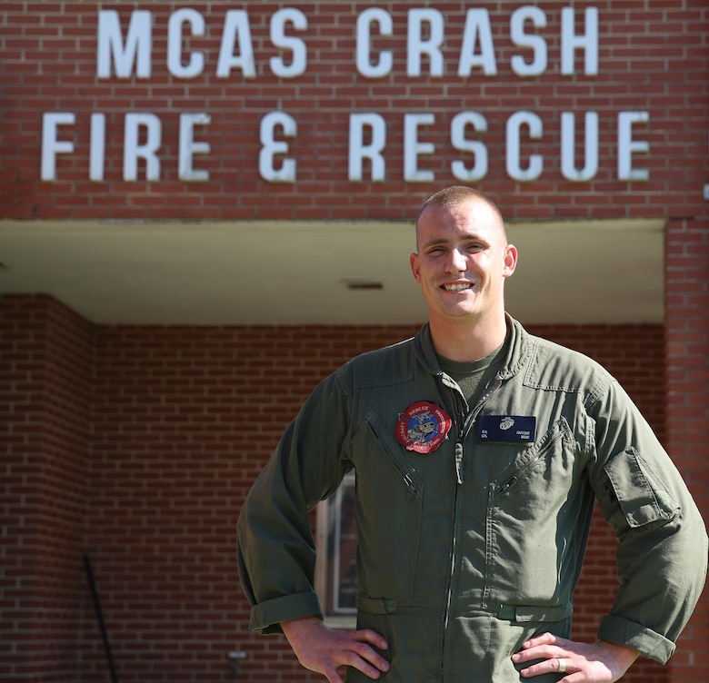 Cpl. Ryan Sargent poses in front of his unit building aboard Marine Corps Air Station Cherry Point, N.C., July 18, 2016. Sargent is a firefighter with Aircraft, Rescue and Firefighting aboard MCAS Cherry Point.