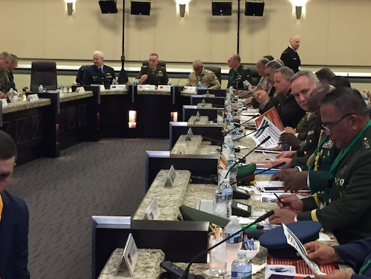 Marine Corps Gen. Joe Dunford, the chairman of the Joint Chiefs of Staff, welcomes 43 chiefs of defense to a discussion on combating global violent extremism at Joint Base Andrews, Md., Oct. 17, 2016. The chiefs are looking for ways to enhance their understanding of the threat and to fit into a global network against extremism. DoD photo by Jim Garamone