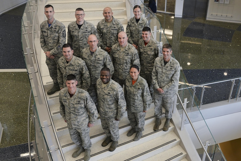 Airmen from the Fort Meade First Sergeants council pose for a photo during the Additional Duty First Sergeant Symposium Oct. 17 2016 at Fort George G. Meade, Md. 53 Airmen were selected between the 70th Intelligence, Surveillance and Reconnaissance Wing, Defense Information School, Defense Media Activity, U.S. Cyber Command, 318th Cyber Operations Group, and the 315th Cyber Operations Squadron to participate in 2016 symposium. (U.S. Air Force photo/Staff Sgt. Alexandre Montes)