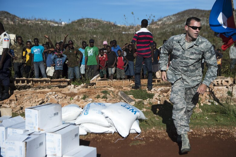 Master Sgt. Gabriel Peterson, of the 290th Joint Communications Support Element, delivers cooking supplies to citizens of Beaumont, Haiti, Oct. 13, 2016. Peterson is part of Joint Task Force Matthew, which has delivered more than 440 tons of supplies to Haitian citizens affected by Hurricane Matthew. (U.S. Air Force photo/Tech. Sgt. Russ Scalf)