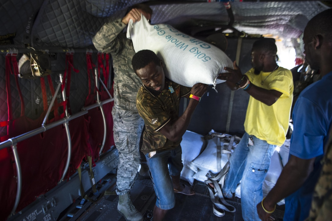 U.S. service members and citizens of Beaumont, Haiti, unload supplies from a CH-47 Chinook Oct. 13, 2016. Service members part of Joint Task Force Matthew have delivered more than 440 tons of supplies to Haitians affected by Hurricane Matthew. (U.S. Air Force photo/Tech. Sgt. Russ Scalf)