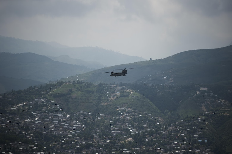 An Army CH-47 Chinook returns to Port-au-Prince, Haiti, Oct. 10, 2016. The aircraft delivered aid in support of Joint Task Force Matthew's mission of providing humanitarian aid to those affected by Hurricane Matthew. (U.S. Air Force photo/Tech. Sgt. Russ Scalf)