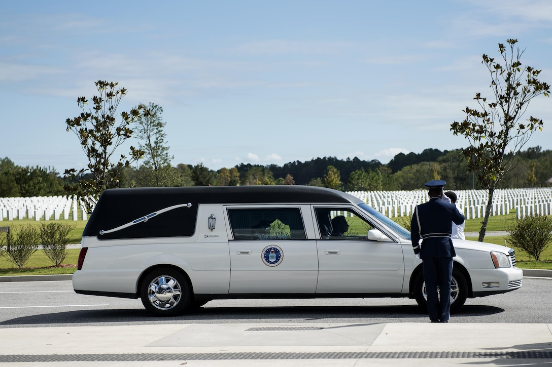 A member of the Moody Air Force Base Honor Guard salutes a hearse during a funeral, Oct. 13, 2016, in Jacksonville, Fla. For this particular funeral, Moody's honor guard took 21 members, splitting them into various details to perform military honors for a fallen active-duty member. (U.S. Air Force photo by Airman 1st Class Janiqua P. Robinson)