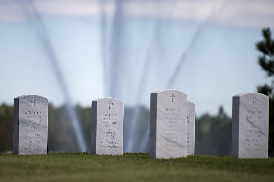 Tombstones sit in Jacksonville National Cemetery where an active-duty member was laid to rest, Oct. 13, 2016, in Jacksonville, Fla. The cemetery accommodates casketed and cremated remains with visitation hours running from sunrise to sunset. (U.S. Air Force photo by Airman 1st Class Janiqua P. Robinson)