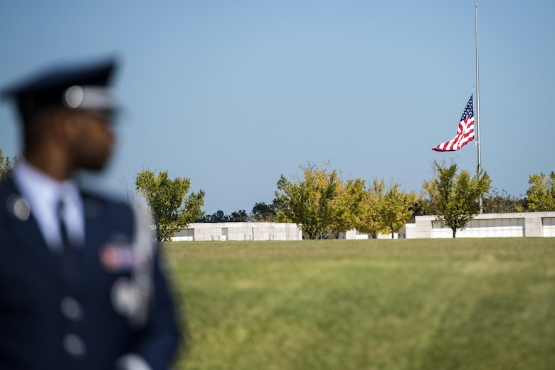A member of the Moody Air Force Base Honor Guard looks at the United States flag at half-mast before a funeral, Oct. 13, 2016, in Jacksonville, Fla. Moody's honor guard, also known as the Knights of Honor, are comprised of up to 25 active duty Airmen. (U.S. Air Force photo by Airman 1st Class Janiqua P. Robinson)