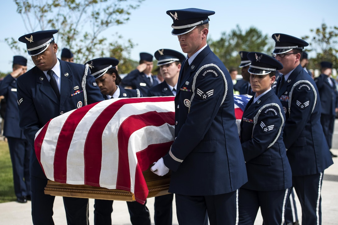 Members of the Moody Air Force Base Honor Guard carry the casket of a fallen active duty military member during a funeral, Oct. 13, 2016, in Jacksonville, Fla. The six-person pallbearer team is responsible for removing the casket from the hearse, carrying it to the casket stand and folding the flag that is given to the family. (U.S. Air Force photo by Airman 1st Class Janiqua P. Robinson)