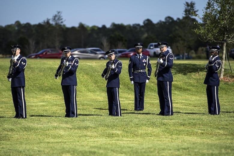Members of the Moody Air Force Base Honor Guard fire rifles during a funeral, Oct. 13, 2016, in Jacksonville, Fla. After going through a series of detailed commands, the firing party leader gives the command to fire, at which time the party goes through a series of movements while striving to fire at the same time. (U.S. Air Force photo by Airman 1st Class Janiqua P. Robinson)