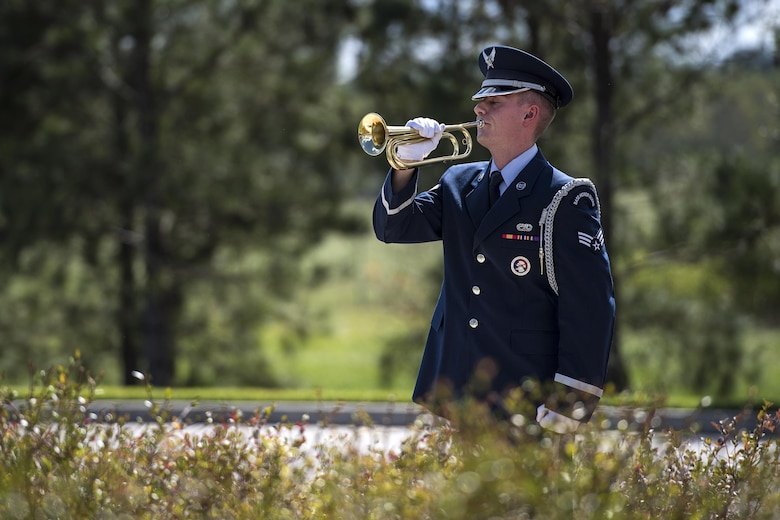 A member of the Moody Air Force Base Honor Guard plays 'Taps' on a bugle horn during a funeral, Oct. 13, 2016, in Jacksonville, Fla. 'Taps' was composed in 1862 and is a played at dusk, during flag ceremonies and at military funerals. (U.S. Air Force photo by Airman 1st Class Janiqua P. Robinson)