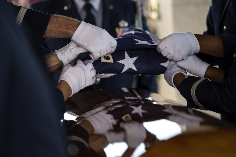 Members of the Moody Air Force Base Honor Guard fold the United States flag during a funeral, Oct. 13, 2016, in Jacksonville, Fla. The pallbearers work together to ensure the flag is folded properly before presenting it to a loved one. (U.S. Air Force photo by Airman 1st Class Janiqua P. Robinson)