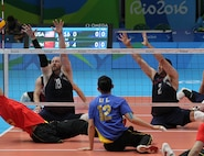 U.S. Paralympian J. Dee Marinko, No. 18, left, prepares to block the ball during the Sept. 16 sitting volleyball match versus China. Team USA played four matches against tough competition during the 2016 Paralympic Games in Rio de Janeiro. Marinko is a production controller with the 550th Commodities Maintenance Squadron. (Photo by John Kessel)