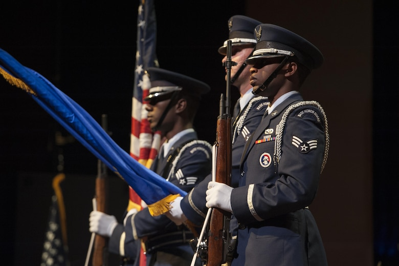Members of the 633rd Air Base Wing Honor Guard post the colors during a U.S. Air Force Heritage of America Band Concert at the Ferguson Center for the Arts in Newport News, Va., Oct. 1, 2016. The 633rd ABW Honor Guard participates in more then 300 events a year including military funeral honors, military ceremonies, and community functions. (U.S. Air Force photo by Staff Sgt. Nick Wilson)