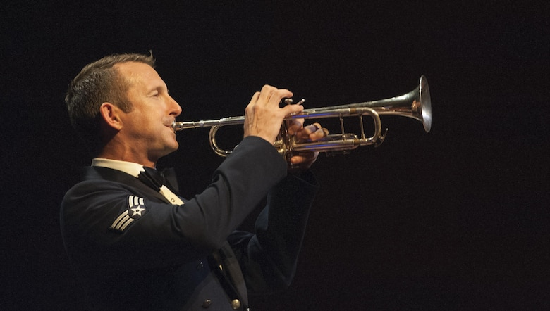 Senior Airman Mark Oates, U.S. Air Force Heritage of America Band trumpet player, plays a solo during a USAF HOAB 75th Anniversary Band Concert at the Ferguson Center for the Arts in Newport News, Va., Oct. 1, 2016. Oates received a Bachelor's of Music degree from James Madison University where he was the second brass player in University history to win the annual concerto competition, and was twice selected as a member of the All-American Band. (U.S. Air Force photo by Staff Sgt. Nick Wilson)