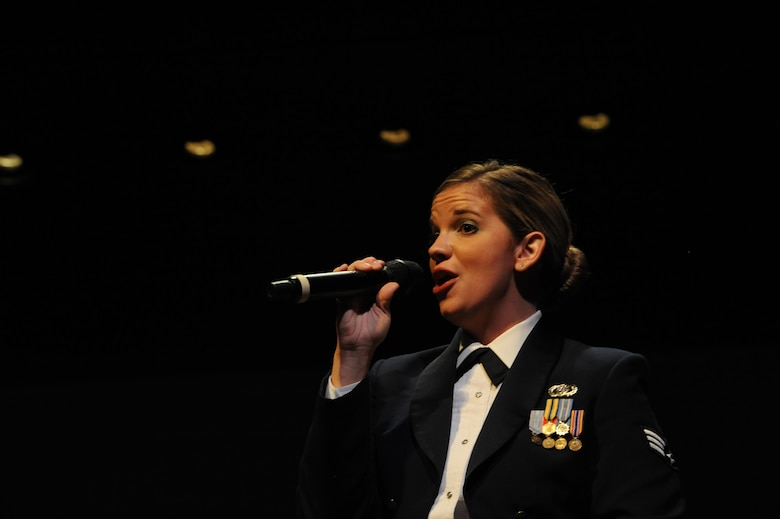 "Senior Airman Melissa Lackore, U.S. Air Force Heritage of America Band vocalist, sings ""At Last"" during a USAF HOAB 75th Anniversary Band Concert at the Ferguson Center for the Arts in Newport News, Va., Oct. 1, 2016. Prior to joining the Air Force, SrA Lackore taught K-12 vocal music in the Iowa public school system, as well as, High School vocal, instrumental music and music theory in Nebraska Catholic schools. (U.S. Air Force photo by Staff Sgt. Nick Wilson)"